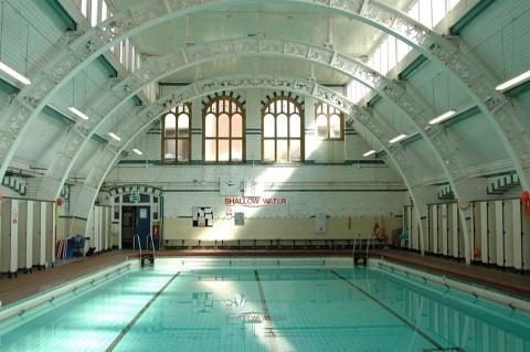Moseley Road Baths - empty pool with tall ceilings and skylights