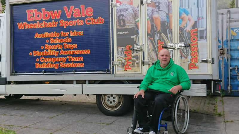 Our vice chairman Anthony along side Rollie our van for our outreach programs and club away days. ROLLIE ON THE ROAD.