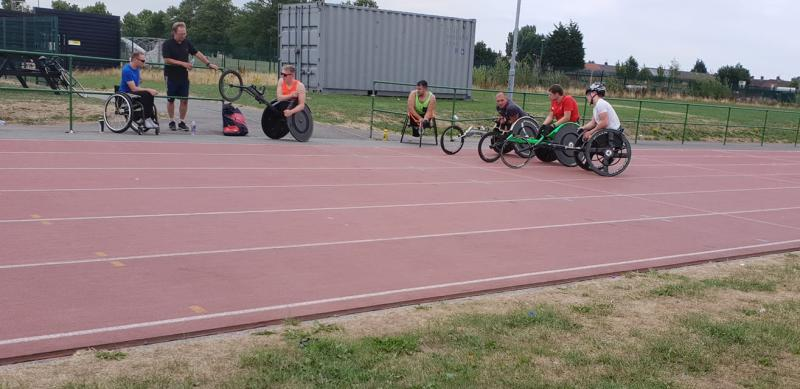Our wheelchair racers training at Kirkby High Schools athletics track.