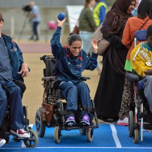Person in a wheelchair playing Boccia