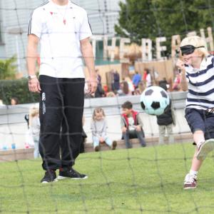 Blindfolded boy takes a shot at blind football