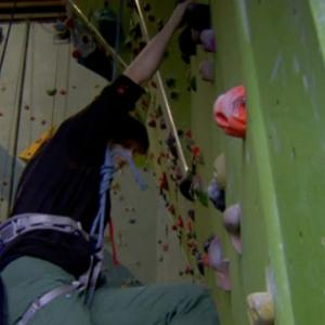 Sianagh Gallagher climbing on an indoor wall
