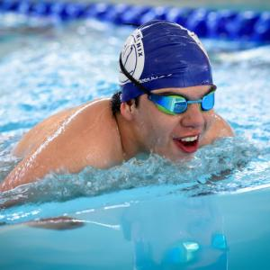male swimmer smiling
