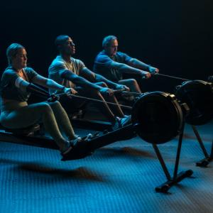 Three rowers try rowing on a machine