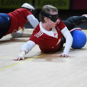 People playing goalball while wearing a blindfold