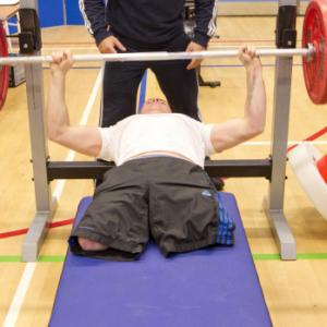 Bench pressing in a gym