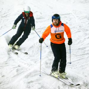 A visually impaired skier and her guide