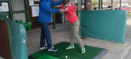 Golf pro helping SDGC member with their golf swing